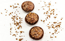 Chocolate bonbons with peanut pieces on white background Royalty Free Stock Photography