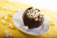 Chocolate Bowl of Popcorn. Chocolate covered popcorn in a milk chocolate bowl royalty free stock photo
