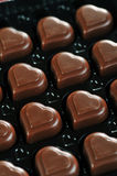 Chocolate in box. Heart shape delicious chocolate in box  close-up Royalty Free Stock Photos