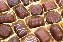 Chocolate in box. Chocolate in yellow box, horizontal picture Stock Photography