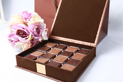 Chocolate box with flowers. A box of milk and dark chocolates with flowers Royalty Free Stock Photography