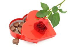 Chocolate box and red rose. Heart shaped chocolates in a red box with a beautiful red rose stock photos