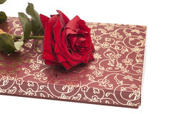Chocolate box and red rose Stock Image