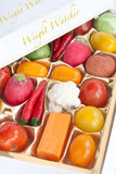 Chocolate box with vegetable and fruit contents Stock Images