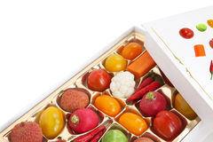 Chocolate box with vegetable and fruit contents Stock Image