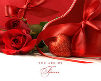 Chocolate boxes with red satin ribbons and roses Royalty Free Stock Image