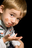 Chocolate Boy. Beautiful boy with brown eyes and a dirty mouth stock photography
