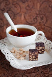 Chocolate bran bars. Bran chocolate bars and cup of tea, selective focus Royalty Free Stock Photos