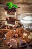 Chocolate branco, escuro, e de leite com porcas Imagens de Stock