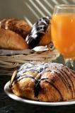 Chocolate bread and orange juice Stock Photos