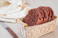 Chocolate bread sliced in wicker basket Stock Images