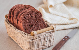 Chocolate bread sliced in wicker basket Stock Photos