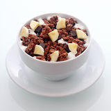 Chocolate breakfast cereal with diced fresh banana Stock Image
