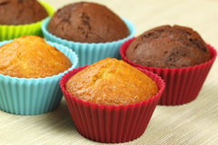 Chocolate and bright cupcakes Royalty Free Stock Photography