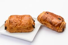 Chocolate brioches. On white dish Royalty Free Stock Photos