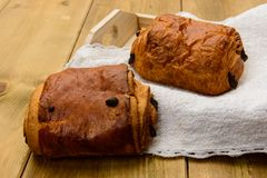 Chocolate brioches. On wooden board Royalty Free Stock Image
