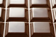 Chocolate brown bar, squares texture Stock Photos