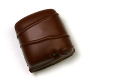 Chocolate with brown stripes. Square chocolate with stripes on a white background Stock Photography
