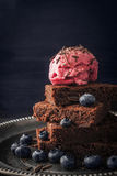 Chocolate brownie with blueberry  and ice cream on the vintage plate vertical Royalty Free Stock Image