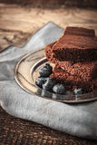 Chocolate brownie with blueberry on the wooden table vertical Royalty Free Stock Image