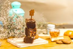 Chocolate brownie cake with cashew nut on wooden background. royalty free stock photography