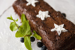 Chocolate brownie cake with fresh blueberry and white sugar stars Royalty Free Stock Photos