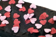 Chocolate brownie cake. With heart decoration royalty free stock photos