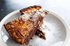 Chocolate brownie cake. With Nut on plate Stock Image