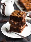 Chocolate brownie cake piece stack on plate homemade pastries Stock Photos