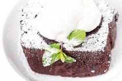 Chocolate brownie cake with vanilla ice cream. Royalty Free Stock Photography