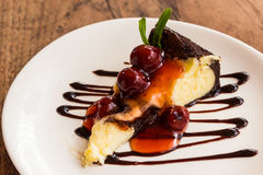 Chocolate brownie cheesecake with cherry fruit. Royalty Free Stock Image