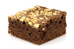 Chocolate brownie with cracked peanuts on top Stock Photography