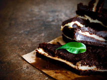 Chocolate brownie. On a dark vintage background Stock Photo