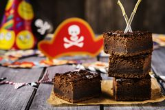 Chocolate brownie. Treats for children`s holiday. Pirate Party Royalty Free Stock Image