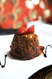 Chocolate Brownie Dessert. Delicious chocolate and toffee brownie, a real fancy dessert and beautifully presented on a white plate royalty free stock image