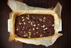 Chocolate brownie with hazelnuts, baking Stock Photography