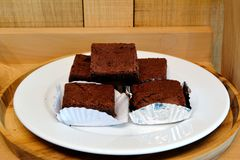 Chocolate brownie. Homemade Chocolate Brownie on a plate against a wooden background Stock Images