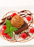 Chocolate Brownie with ice cream and raspberries. Chocolate brownie with ice cream and fresh raspberries Royalty Free Stock Image