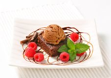 Chocolate Brownie with ice cream and raspberries. Chocolate brownie with ice cream and fresh raspberries Royalty Free Stock Images