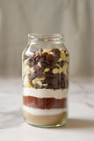 Chocolate brownie ingredients in a glass jar Royalty Free Stock Photos