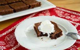 Chocolate brownie portions stock photo