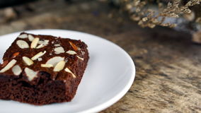 Chocolate Brownie. Put on a wood table with dark roasted coffee beans Stock Photo
