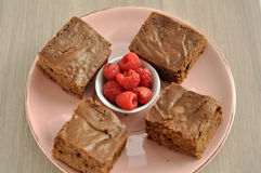 Chocolate Brownie with Raspberries Stock Images