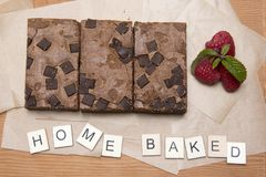 Chocolate brownie slices with raspberries Stock Photos