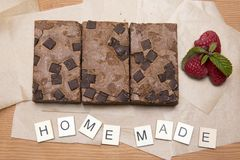 Chocolate brownie slices with raspberries Royalty Free Stock Image