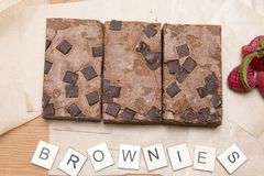 Chocolate brownie slices with raspberries Stock Images