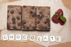 Chocolate brownie slices with raspberries Stock Image