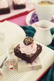 Chocolate brownie and strawberry frosting Royalty Free Stock Images