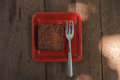 Chocolate brownie. With chocolate syrup on a wooden table Stock Photos