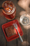 Chocolate brownie. With chocolate syrup on a wooden table Royalty Free Stock Image